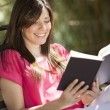 Happy girl reading a book — Stock Photo
