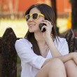 Happy girl talking on the phone — Stock Photo