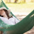 Young girl sleeping in a hammock — Stock Photo #22156941