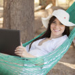Girl with a laptop in a hammock — Stock Photo #22156957