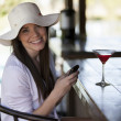 Portrait of a beautiful woman with a glass of wine — Stock Photo