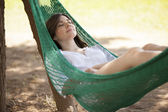 Young girl sleeping in a hammock — Stock Photo