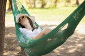 Young girl sleeping in a hammock — Stock Photo