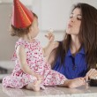 Beautiful woman and child celebrating a birthday — Stock Photo