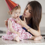 Beautiful woman and child celebrating a birthday — Stock Photo #22872824