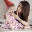 Beautiful woman and child celebrating a birthday — Stock Photo #22872824