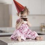 Cute little girl eating cake — Stock Photo #22872846