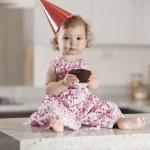 Cute little girl eating cake — Stock Photo #22872860