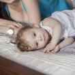Young mother and her daughter on bed — Stock Photo #22872970