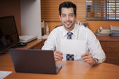 Portrait of a happy successful mature business man holding card — Stock Photo