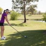 Beautiful girl golf player — Stock Photo