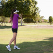 Beautiful girl golf player — Stock Photo