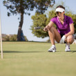 Beautiful girl golf player — Stockfoto