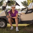 Beautiful and young golfer - Stock Photo