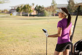 Beautiful and young golfer — Stockfoto