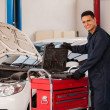 Foto Stock: Mechanic with tool box
