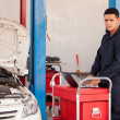 Stock Photo: Mechanic works with laptop