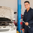 Mechanic holding a wrench at a car garage — Stockfoto