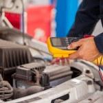 A mechanic checks the engine — Stock Photo