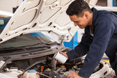 Mechanic changing a car filter — Stock Photo