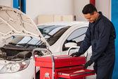 Mechanic with tool box — Stock Photo