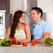 Stock Photo: Couple looking at each other in kitchen