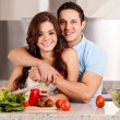 Couple making a salad together — Stock Photo