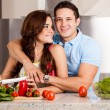 Stock Photo: Couple cooking dinner together