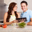 Couple looking for a dinner recipe in tablet computer — Stock Photo