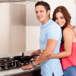 Couple cooking dinner together — Stock Photo #29234891
