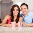 Stock Photo: Young man and his girlfriend drinking some coffee together