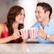 Young man and his girlfriend drinking some coffee together — Stock Photo #29234903