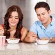 Couple has breakfast together — Stockfoto