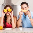 Couple playing around with some fruit — Stock Photo