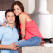 Happy young couple in the kitchen — Stok fotoğraf