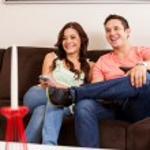 Couple watching TV — Stock Photo
