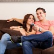 Постер, плакат: Couple watching TV