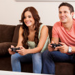 Couple playing video games — Stock Photo #29234945