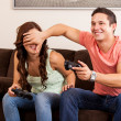 Young man cheating on a video game — Stock Photo