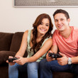 Couple playing video games together — Stock Photo #29234957