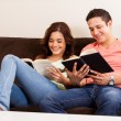 Young couple reading a book together — Foto Stock