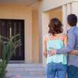 Couple looking at their new house — Stock Photo #29235087