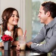 Happy couple at a restaurant — Stock Photo