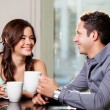 Hispanic couple drinking coffee — Stock Photo