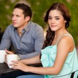 Brunette drinking coffee on a first date — Stock Photo