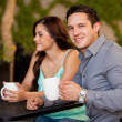 Young man and his girlfriend having some coffee — Stock Photo