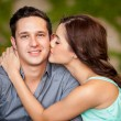 Girl kissing her handsome boyfriend — Stock Photo