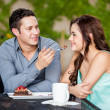 Man sharing cake with his date — Stock Photo