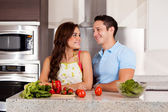 Couple looking at each other in the kitchen — Stock Photo