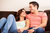 Couple relaxing on the couch — Stockfoto